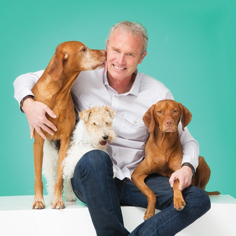 Photo courtesy of FidoTV — FidoTV founder Tad Walden with Tok, Madison and Kai.