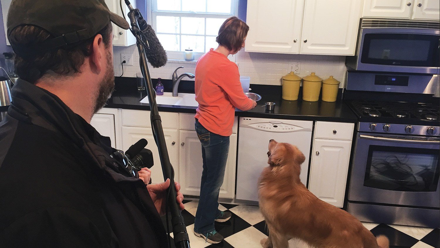 "Photo courtesy of FidoTV — Professional dog handler Leslie Racine of Charleston appears in ""Which Woof is for Me?"" with one of her Golden Retrievers."