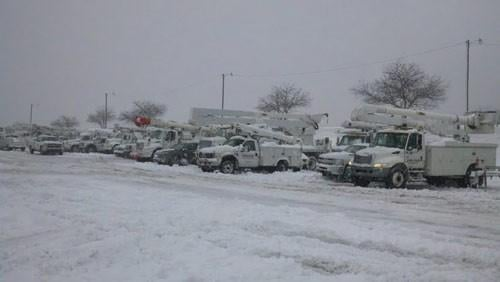 Utility trucks line up in Raleigh County to repair downed lines following superstorm Sandy's destruction in West Virginia.