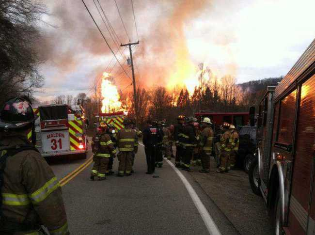 The State Journal file photo / Firefighters from throughout the region respond to a gas pipeline explosion in Sissonville in December.