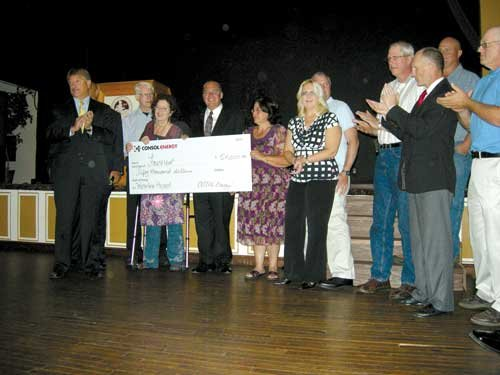 Gov. Tomblin and local officials accepted $50,000 from Consol Energy, half of a donation for a water line extension. Consol COO for Coal James Brock stands at left; Sr. VP for Northern WV Operations Chuck Shaynak is at right in a dark jacket.