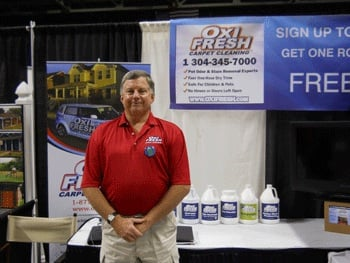 Jeff Pickering stands in front of an Oxi Fresh Carpet Cleaning booth at the West Virginia Home Show earlier this year.