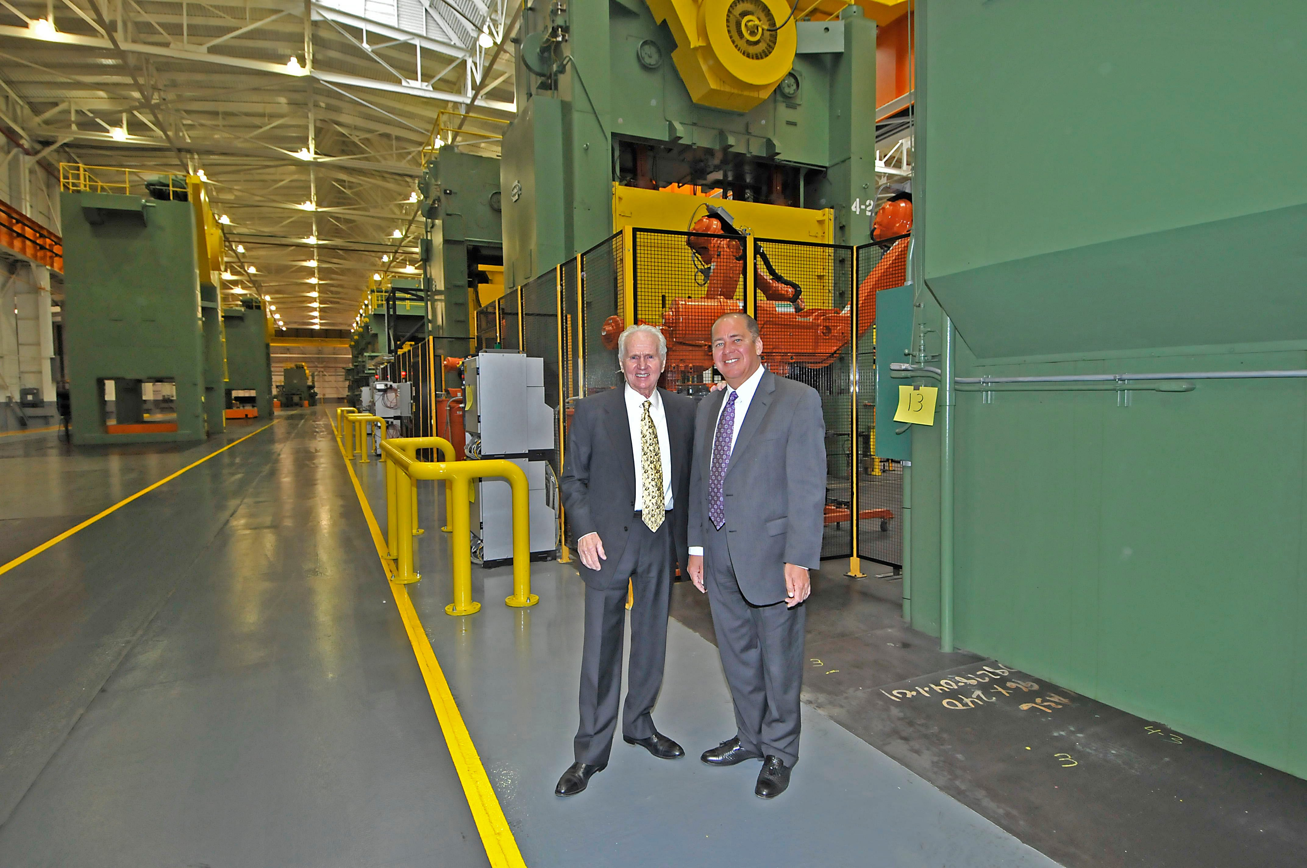 Photo courtesy of Gov. Earl Ray Tomblin's office / Ray Park, chairman of the Park Corp., and Gov. Earl Ray Tomblin tour the former South Charleston Stamping and Manufacturing Plant.