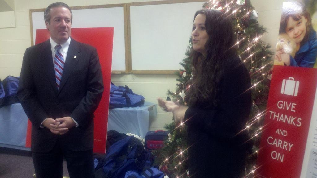 Booth Goodwin, left, and Carrie Dawson talk about the Give Thanks and Carry On program, which gives foster kids luggage.