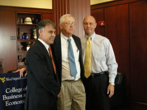 "WVU College of Business and Economics Dean Jose ""Zito"" Sartarelli, left, with alumnus J. Michael Bodnar and WVU President James Clements at Nov. 28 event celebrating Bodnar's gift of $1 million."