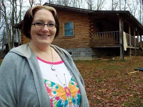Amy Simmons' husband still works in the coal mine, though the family is no stranger to layoffs.