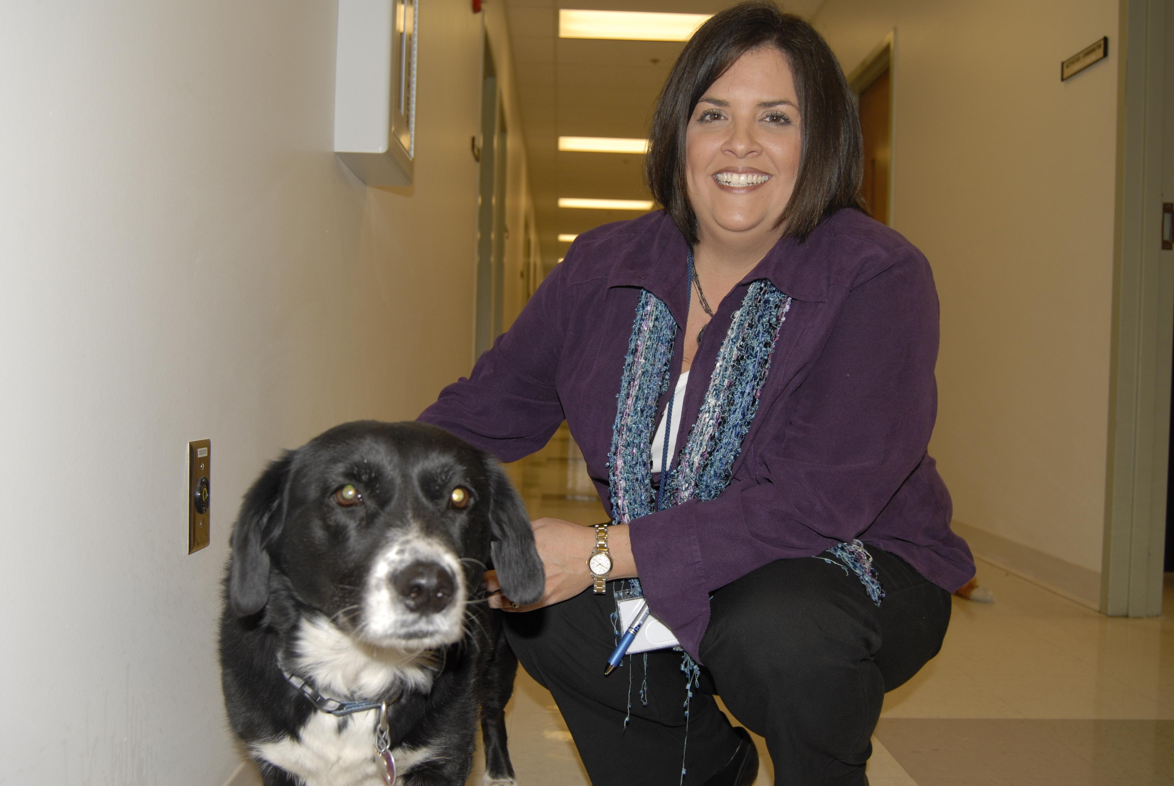 Photo by Andrea Lannom. Superintendent Stephanie Bond shows off Sadie, the center's pet.