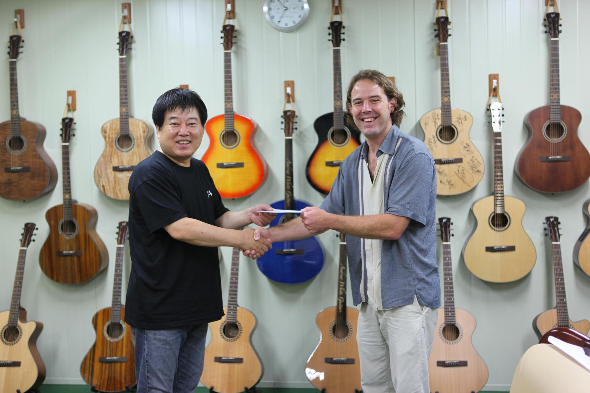 Photos courtesy of Andrew White / Guitar accessories maker B. Y. Lim (left) licensed the designs of Morgantown luthier Andrew White to make, market and distribute the Goddess series of guitars in Paju City, South Korea.