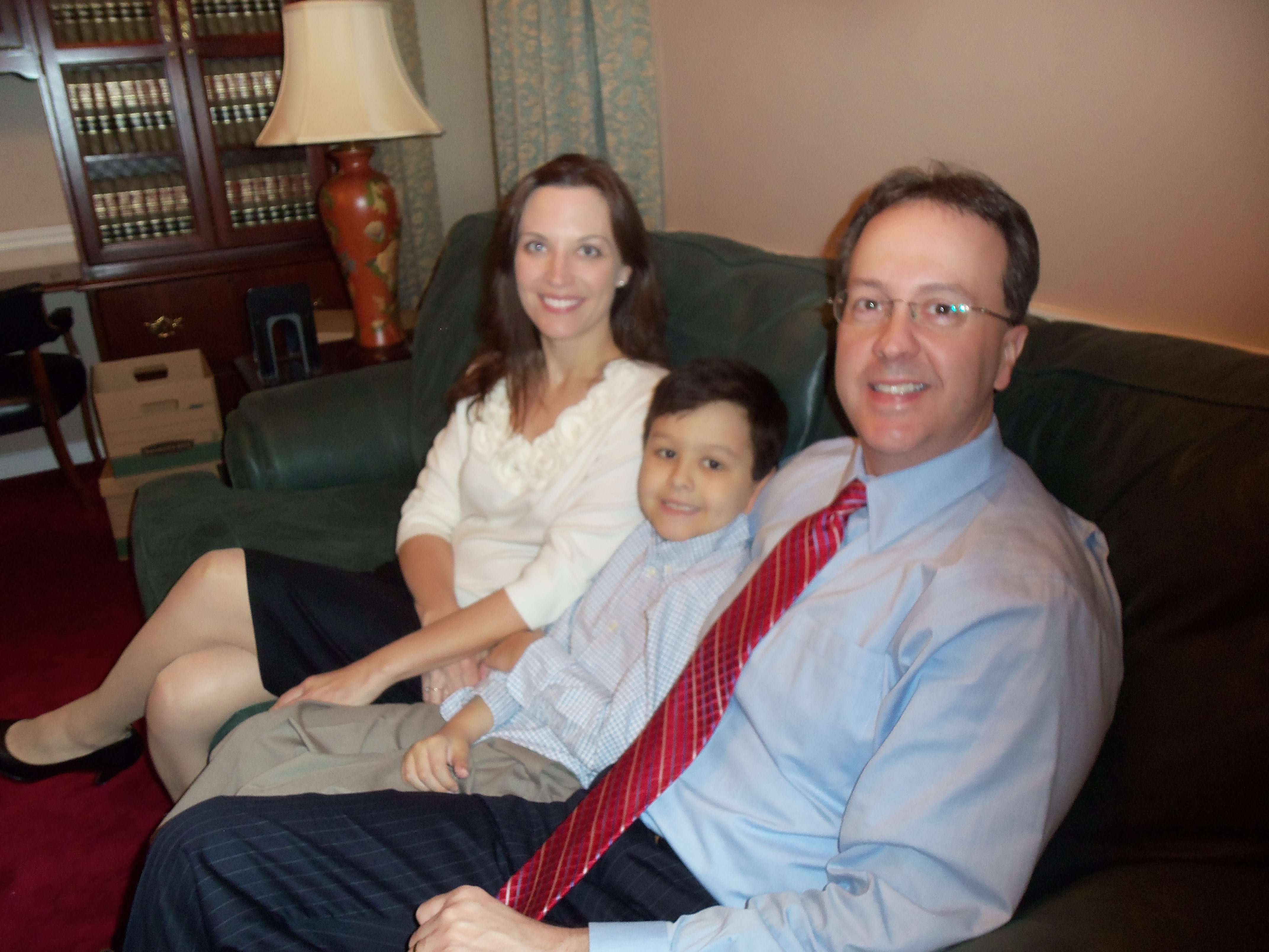 Allen Loughry sits in his new office with his son Justus and wife Kelly.