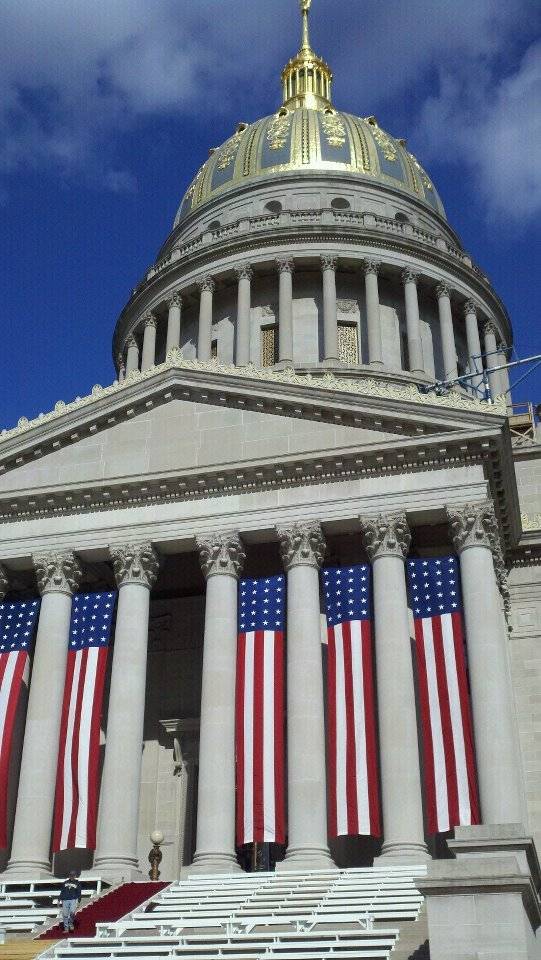 Workers prepare the Capitol for the 2011 inaugural ceremony.