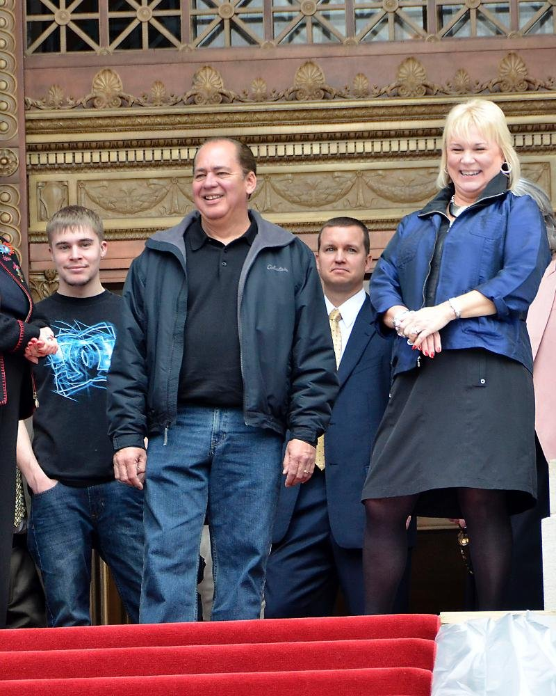 The Tomblin family shares a laugh during inaugural preparations Sunday.