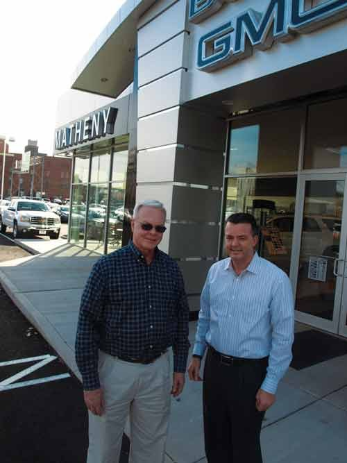 Mike Matheny, left, and Tim Matheny recall how Matheny Motors began in 1922 in Parkersburg and has expanded in the past 10 years.