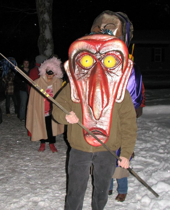 Photo courtesy of www.helvetiawv.com / A Fasnacht participant participates in the annual burning of Old Man Winter during the 2010 festival.