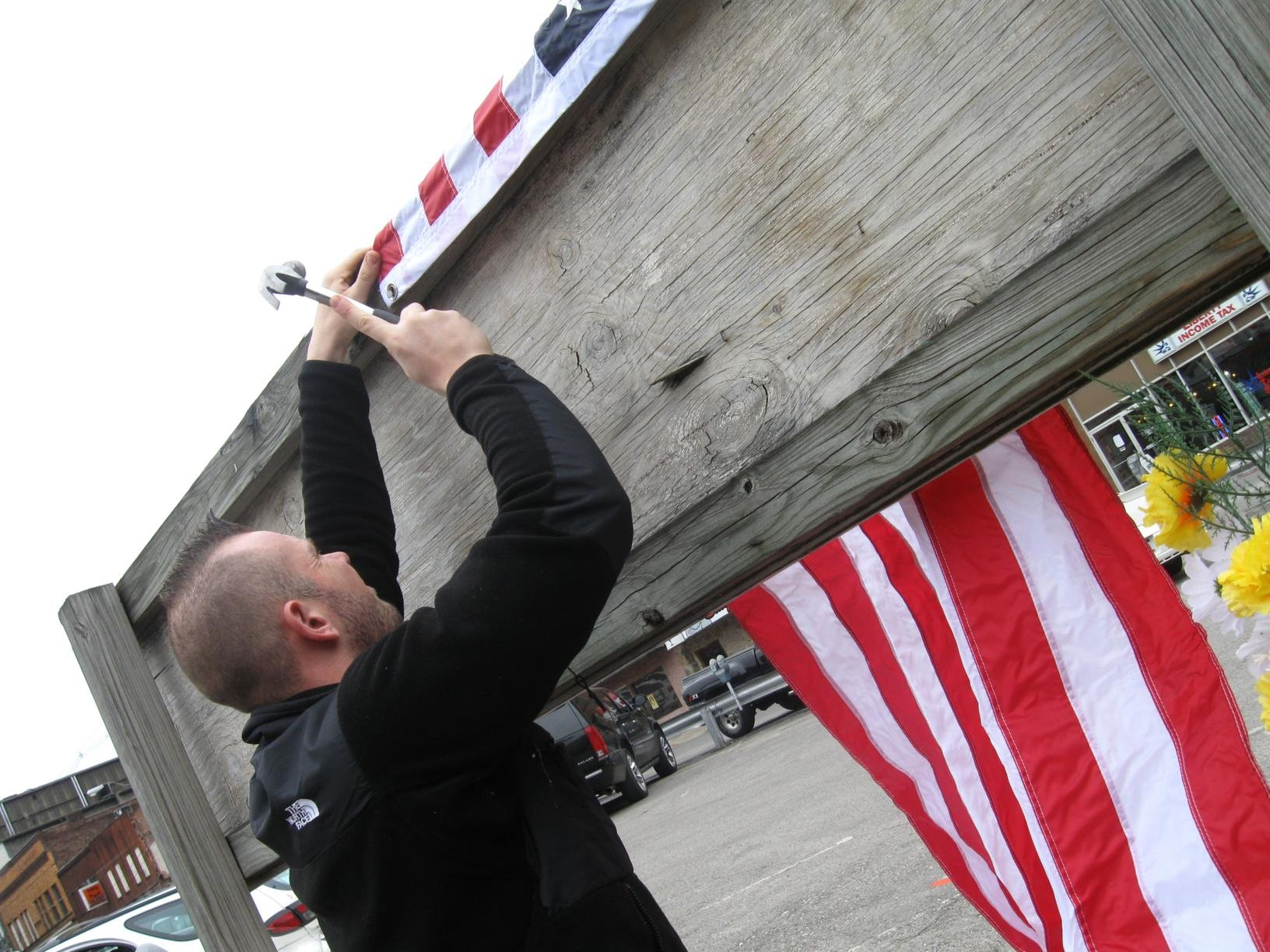 Nathan Lamere hung a flag in honor of Crum.
