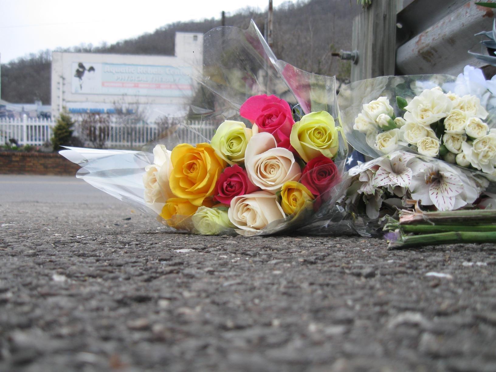 Flowers adorned Crum's memorial.