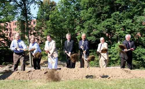 President of West Liberty University, Robin Capehart, center, is proud of the growth on campus. He helps to break ground on the construction of Campbell Hall of Health Sciences.