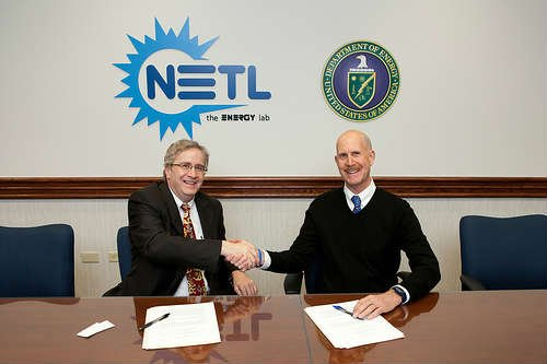 NETL Director Anthony Cugini (left) and NIOSH Director John Howard sign a memorandum of understanding April 22 to research airborne emissions and air quality at natural gas drilling sites.