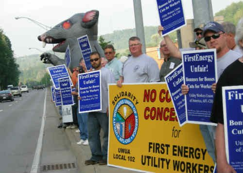 Union members demonstrated with the utility workers' iconic rat during the morning commute in Morgantown. The workers protested outside FirstEnergy's annual shareholder meeting.