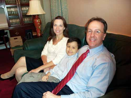 Allen Loughry relaxing with his wife, Kelly, and son Justus.