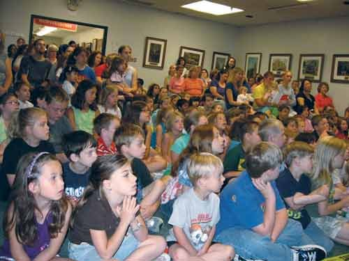 Photo courtesy of Wood County Library. Wood County Library's 2009 summer reading program was packed with eager children.