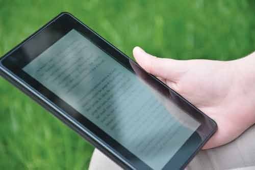 E-readers, such as the Amazon Kindle, are becoming more popular, changing how library directors purchase material for their collections.
