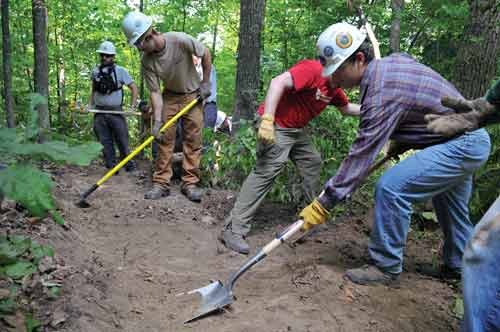 Boy Scout Order of the Arrow members do advance work on hiking and biking trails along the New River Gorge National River.