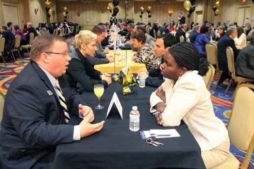Doug Evans talks with Delegate Meshea Poore, D-Kanawha, at the Alliance's 2012 Speed Networking with the Stars.