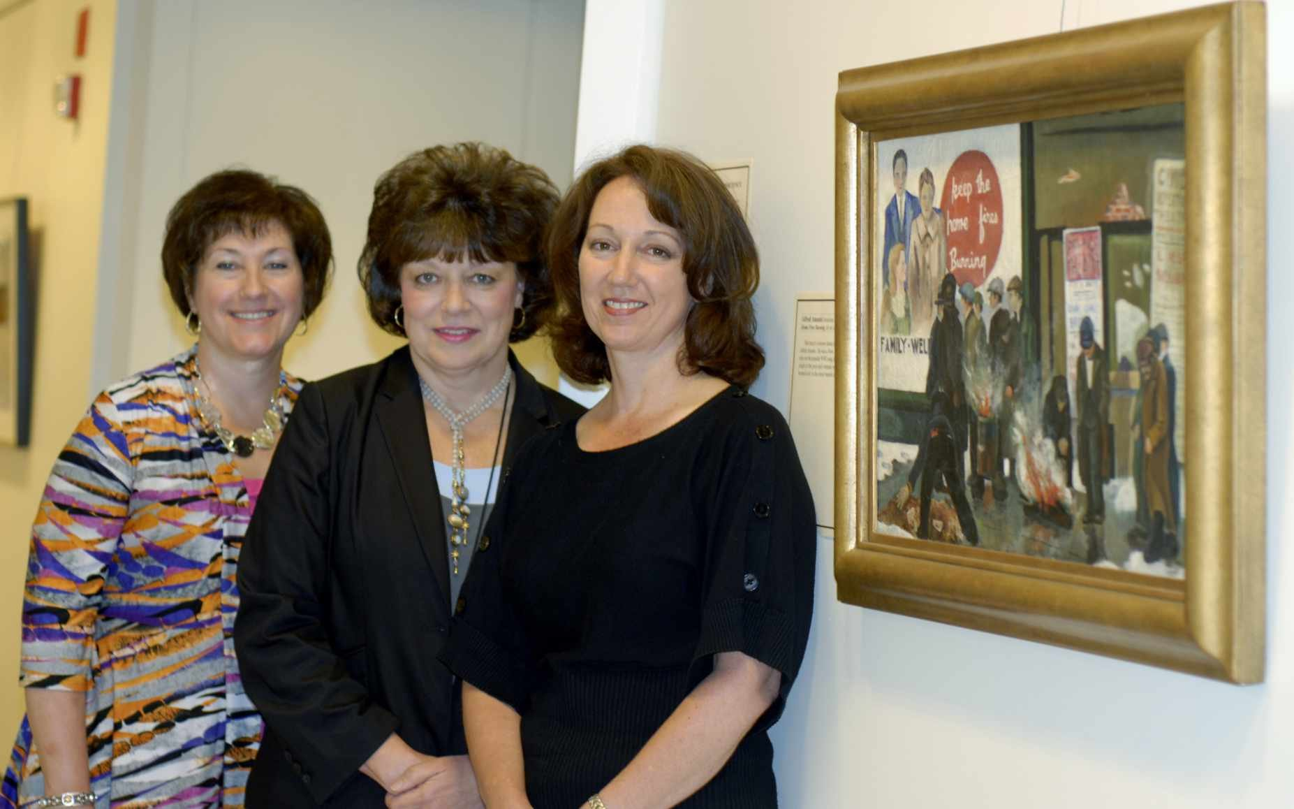 Kris Gerencir, chief deputy of the U.S. District Court for the Southern District of West Virginia, and federal clerk Teresa Deppner stand with Jennifer Peyton in front of the court's most recent exhibit, donated from the Peytons' personal collection.