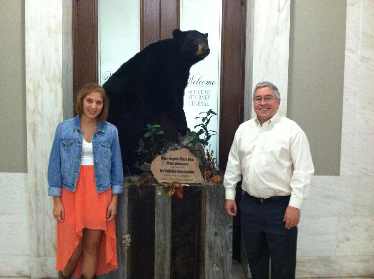 Morrisey stands with 18-year-old Miranda Ware, who harvested the bear. Photo courtesy of the West Virginia Attorney General's office.