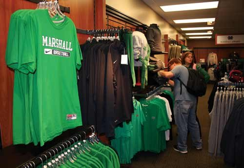 Marshall University students John Bruce, a senior from Huntington, and Brittany Reavis, a freshman from Charleston, shop for apparel at the MU Campus Bookstore.