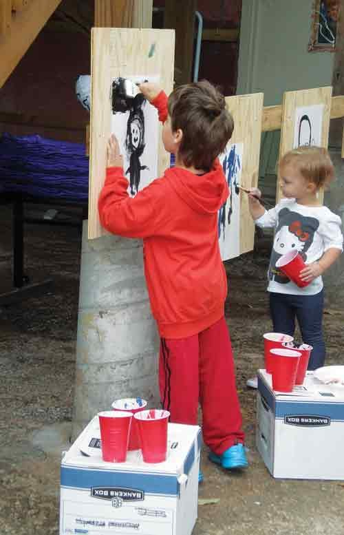 Children take time to practice and display their artwork at the K.I.D.S. grand opening Oct. 12 in Charleston.