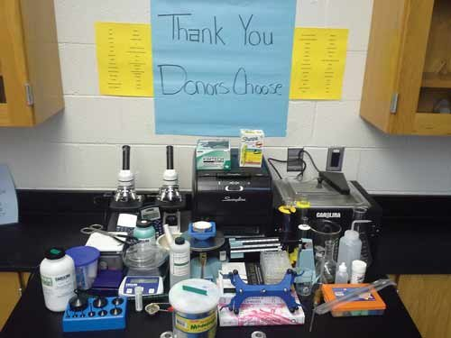 Photo courtesy of Kelly Murray, Preston High School. Kelly Murray, chemistry teacher at Preston High School, displays a sampling of items that have been given to equip the science lab through DonorsChoose.org.