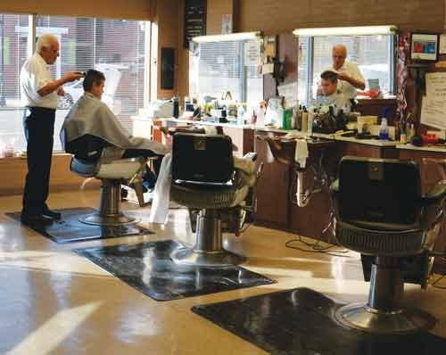 NATALIE BELVILLE / The State Journal Frank Fuscardo has served the Huntington area for 50 years at Frank Fuscardo's Campus Barber Shop on 4th Avenue, near the campus of Marshall University.