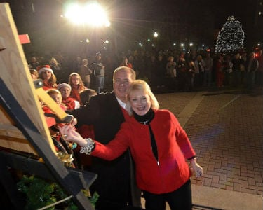 Gov. Tomblin and First Lady Tomblin light the state's holiday tree during the 2012 Joyful Night celebration at the State Capitol. (Photo courtesy of the Governor's office.)