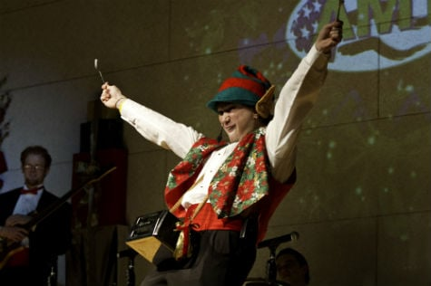 An elf performs during the Christmas Spectacular at The American Mountain Theater