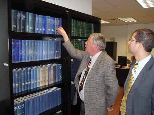 GEORGE HOHMANN / The State Journal. Consultant Karl Lilly, left, and Assistant Clerk of the Senate Lee Cassis look over a complete set of Blue Books in the Legislative Library at the Capitol.