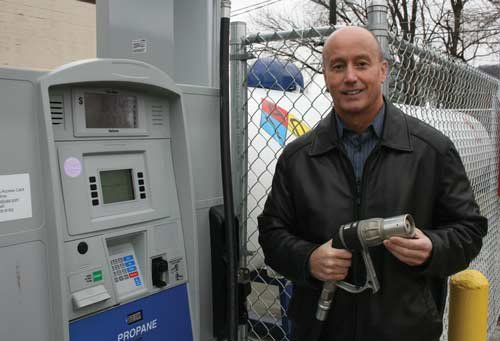 JIM WORKMAN / The State Journal Bret Chandler, directing manager of Propane Fuel Technologies, shows a pump at a liquid propane station in Charleston.