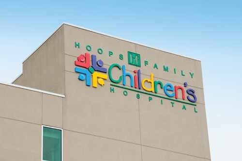 Photo courtesy of Cabell Huntington Hospital. A colorful sign for the new Hoops Family Children's Hospital can be seen atop the hospital complex.