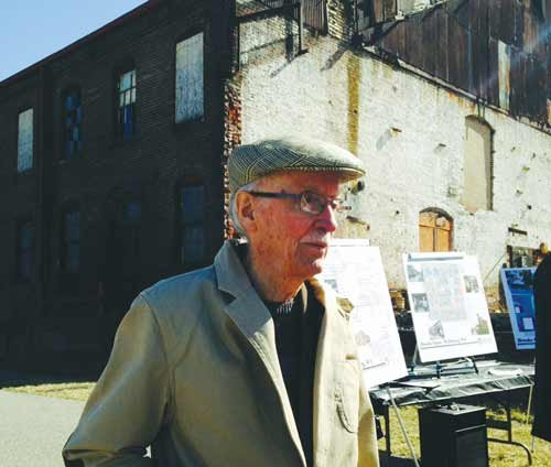 LINDA HARRIS / The State Journal.  Henry Rithner stands in front of the former Brooke Glass factory in Wellsburg.