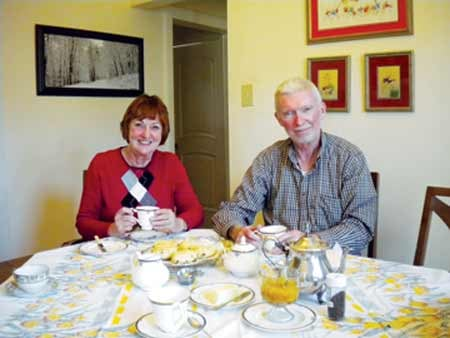 "Missy Sheehan / For The State Journal: Judy Larkin, the ""Tea Lady,"" and husband, Bill Larkin, enjoy a cup of Ceylon tea from Sri Lanka."