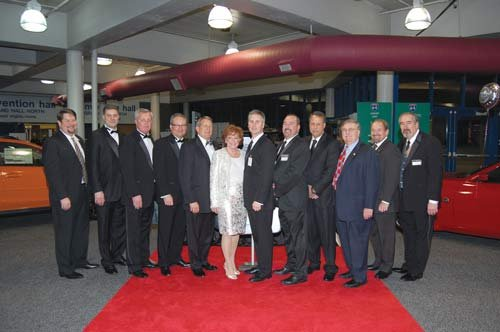 Ruth Lemmon and the West Virginia Automobile and Truck Dealers Association board members pose during the 2012 auto show's VIP night.