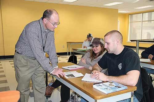 Photo courtesy of Miranda Kessel. Curt Hippensteel, program instructor, works with petroleum tech students enrolled at WV Northern Community College.