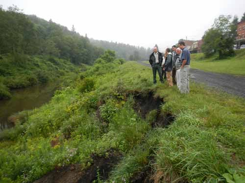 Photo courtesy Green Rivers. Mayor of Thomas, Matt Quattro, and other stakeholders look at the Thomas riverfront that will be assessed using the grant.