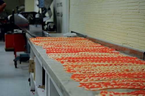 MANDI CARDOSI / The State Journal. Smith Candies is one of the many highlights of downtown St. Marys. The candy shop produces about 100,000 pounds of rock candy each year.