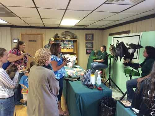 Photo Courtesy of Jodi French-Burr. TRAC Executive Director Wendy Perrone, right, gives a presentation during the group's annual Migration Celebration in May at Little Beaver State Park.