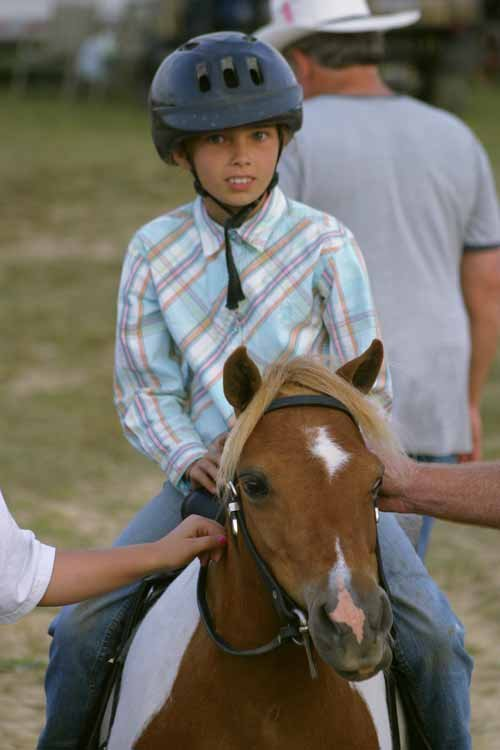 MIKE RUBEN / The State Journal. Youth activities take place across the fairgrounds at the Jackson County Junior Fair, including the horse arena.