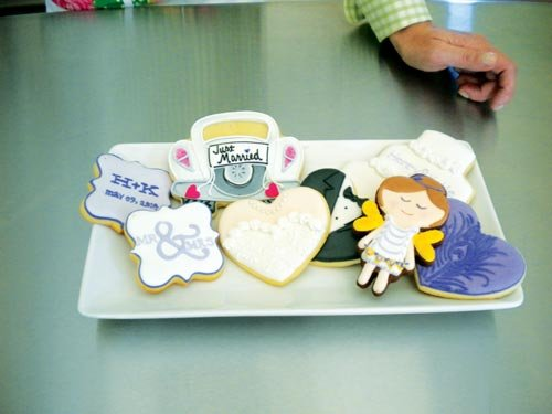 Missy Sheehan / For The State Journal. Sarah Schottler specializes in custom-made cookies, like the wedding-themed cookies pictured. Schottler says the secret to their great taste is freshness and quality ingredients.