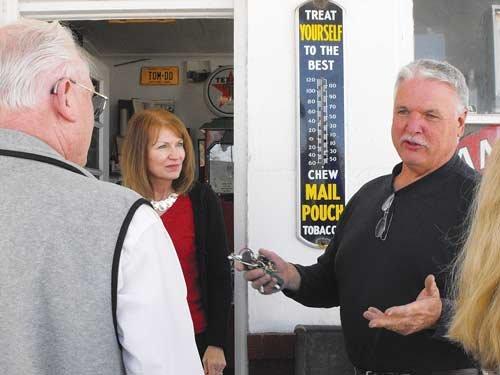 Cynthia McCloud / For The State Journal. Tom Westbrook, owner of Westbrook's Esso, a restored service station in Kingwood, talks to a tour group this spring.