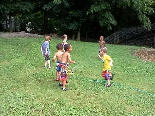 Photo courtesy of Shepherdstown Day Care Center. Students enjoy their weekly water play activity at the Shepherdstown Day Care Center in Shepherdstown.