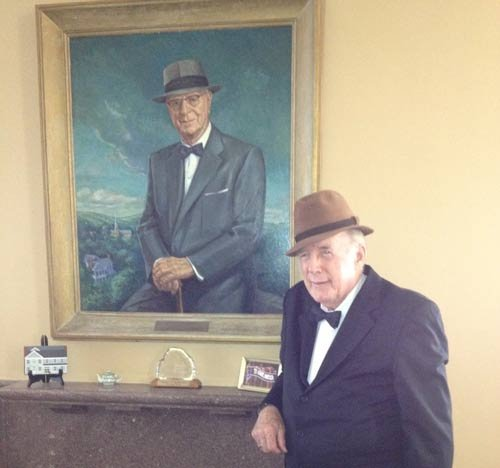 Photo courtesy of National Association of Royalty Owners. George Daugherty poses in front of a portrait of Mike Benedum, aka the Great Wildcatter, of Bridgeport. Daugherty will portray Benedum at the 2014 NARO Appalachia Conference.